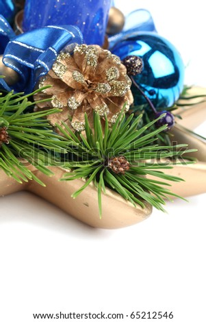 Blue Christmas decorations with pine cone and twigs isolated on white background. Shallow dof