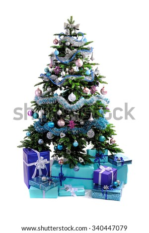 blue Christmas gifts under tree isolated on white background - stock photo