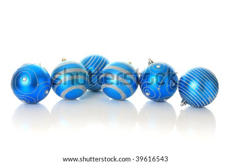 Blue Christmas ornament, isolated in studio with a complete reflection. - stock photo