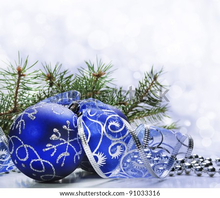 Blue christmas ornament with bokeh background - stock photo