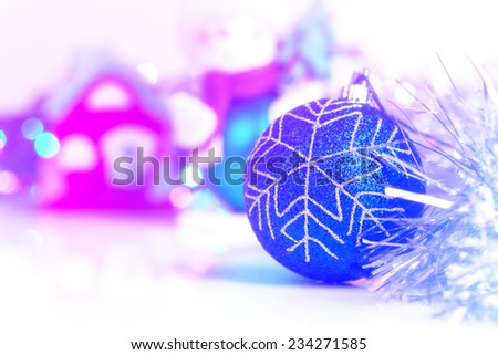 Blue Christmass ball with blury festive glitter lights background - stock photo