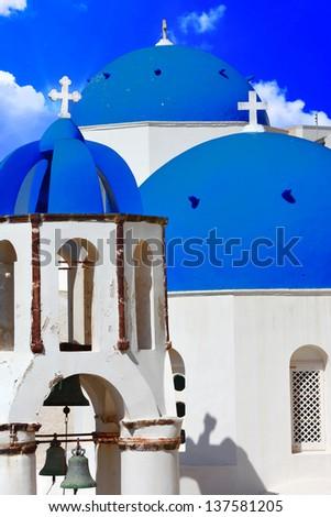 blue churches domes - symbol of unique Santorini - stock photo