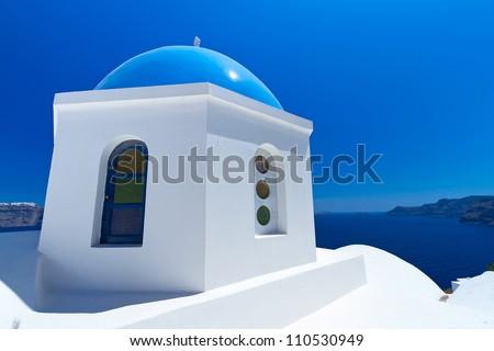 Blue churches of Oia village at Santorini island, Greece - stock photo