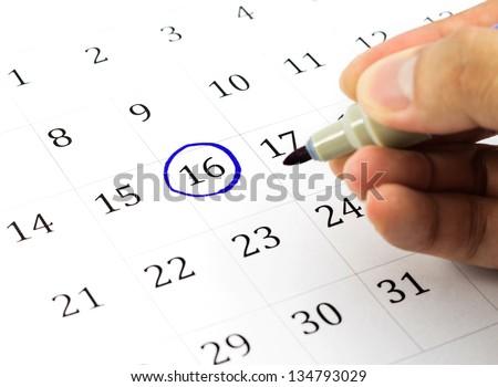 Blue circle. Mark on the calendar at 16. - stock photo