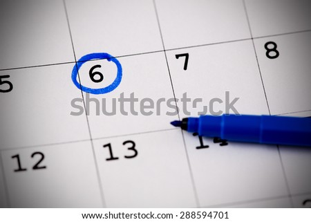 Blue circle. Mark on the calendar at 6. - stock photo