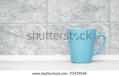 blue circle on the background of marble tiles - stock photo