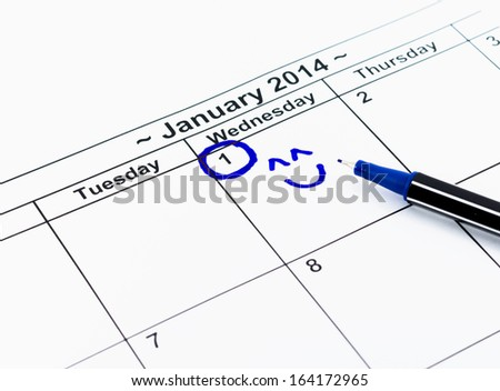 Blue circle with smile. Mark on the calendar at 1St January 2014 - stock photo