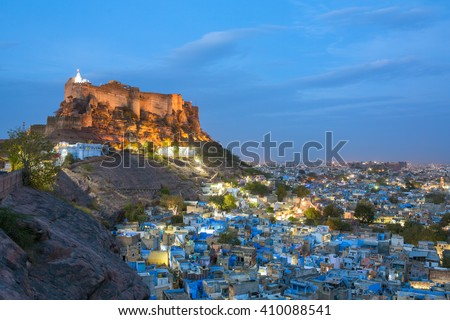 Blue city and Mehrangarh fort on the hill at night in Jodhpur, Rajasthan, India - stock photo