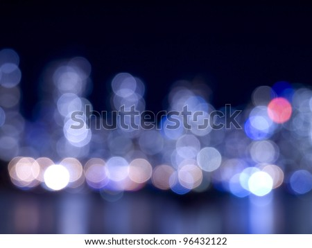 Blue City lights at night and reflection on water - stock photo