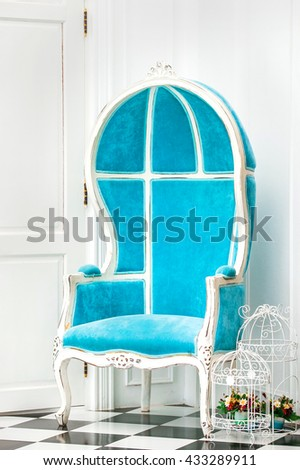 Blue classical style Armchair sofa couch in vintage room - stock photo