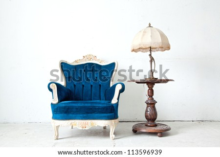 Blue classical style Armchair sofa couch in vintage room with desk lamp - stock photo