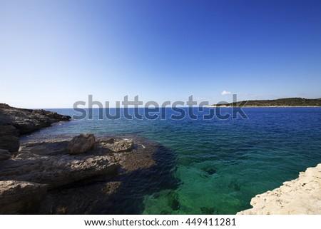 Blue clear sea at sun morning. Mediterranean sea, Turkey. Wide angle view. - stock photo
