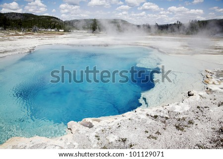 Blue clear waters in Sapphire pool in Yellowstone National Park - stock photo