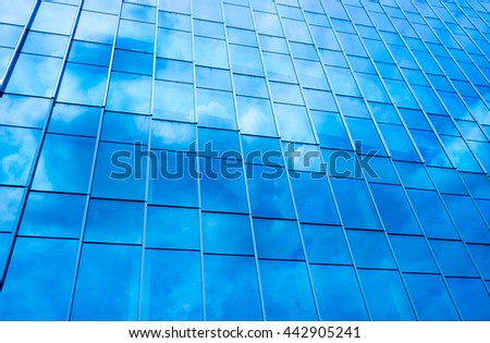 Blue Cloud reflected in windows of office buildings in the background