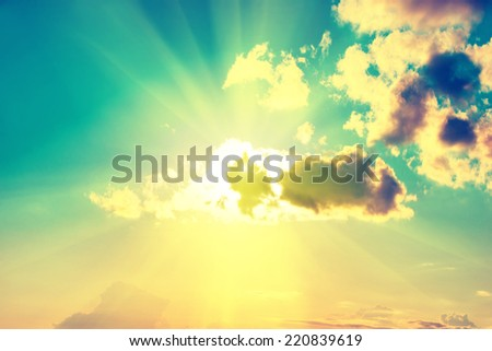 Blue clouds, sun and sky. Natural background, image with Instagram-like filter - stock photo