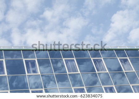 Blue cloudy sky and reflection