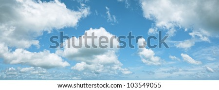 Blue cloudy sky. Panoramic composition in high resolution. - stock photo