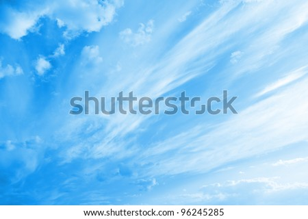 Blue cloudy sky with clouds unusual shapes. - stock photo