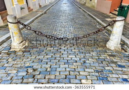 Blue cobblestone streets of San Juan, Puerto Rico. - stock photo