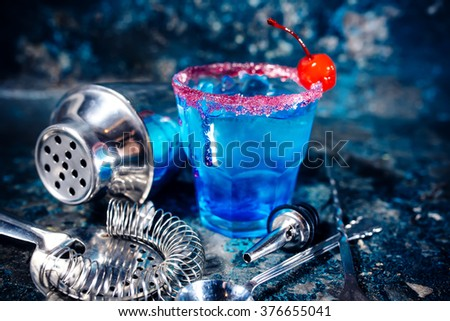 blue cocktail alcoholic drink with fruits and vodka. - stock photo