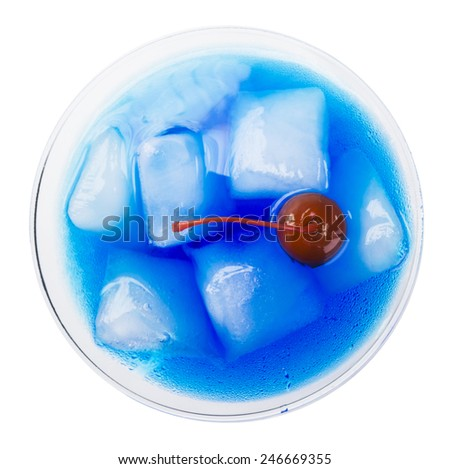 blue cocktail, curacao, red cherry, ice, isolated,  up side - party background - stock photo