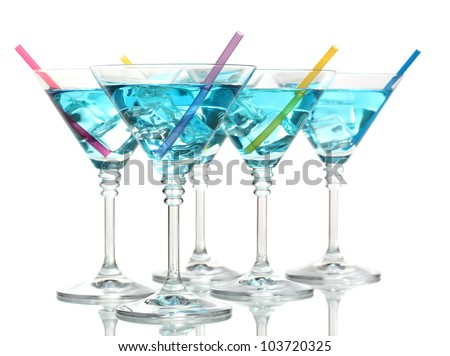 Blue cocktail in martini glasses isolated on white - stock photo