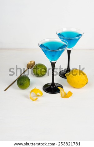 Blue cocktail on the wooden table - stock photo