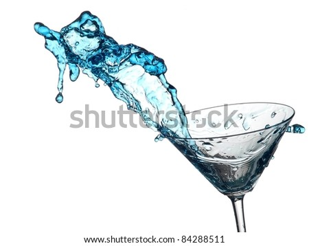 Blue cocktail splash from a glass - stock photo