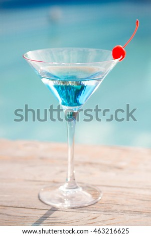 Blue cocktail with a cherry