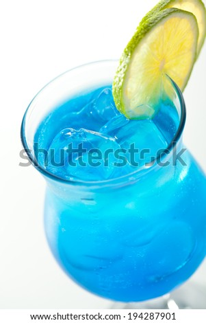 Blue Cocktail with Lime and Ice Cube - stock photo