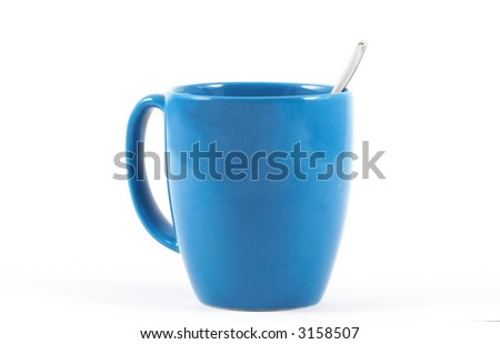 Blue coffee mug with spoon side view on isolated white background, horizontal orientation - stock photo
