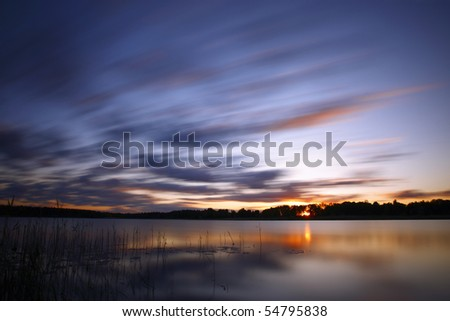 Blue cold sunrise over lake in Estonia - stock photo