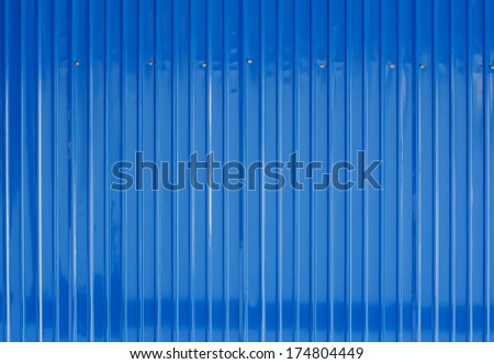 Blue color corrugated metal sheet as background - stock photo