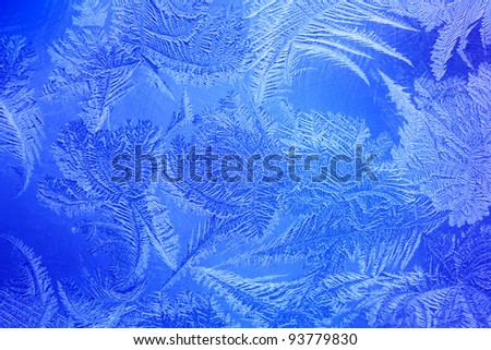 Blue color frost on the window - New Year background - stock photo