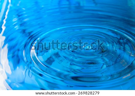 blue color of water drop and water reflection for background - stock photo