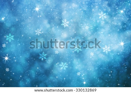 Blue colored abstract blurry snowfall Christmas and New Year illustration background with sparkle. Lovely blue colored holiday greeting card with copy space background. - stock photo