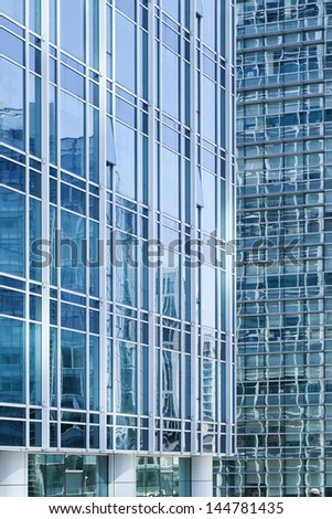 Blue colored glass surface of modern office buildings - stock photo