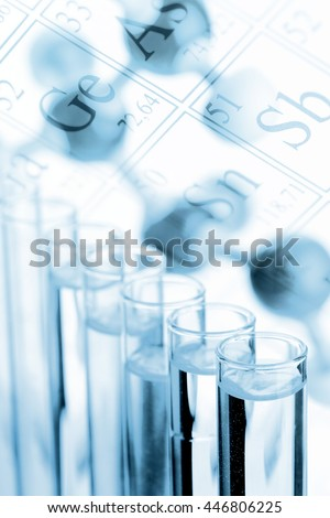 Blue colored test tubes with molecule model  - chemistry or biology science background - stock photo