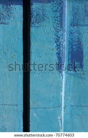 Blue colored wall with texture - stock photo