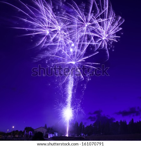 Blue colorful fireworks on night sky background