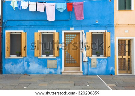 Blue colorful house from Burano, a small island of the venetian lagoon. Italy. Taken on August 21, 2015 - stock photo