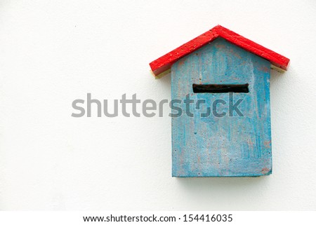 Blue Concrete Mailbox on white wall. - stock photo