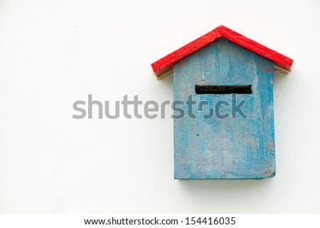 Blue Concrete Mailbox on white wall. - stock photo
