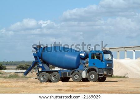 Blue concrete truck mixer in the workmanship - stock photo