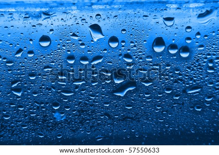 Blue condensation waterdrops on  glass with a back light.