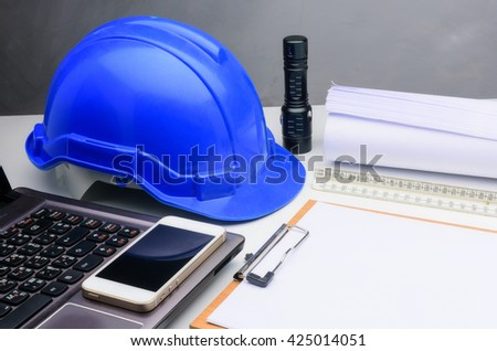 Blue construction helmet notepad,Blue print, pen on table architectural project  - stock photo