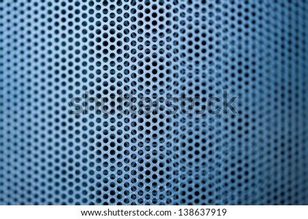 Blue construction metal grill seamless pattern with shallow depth of field. Tilt-shift lens used to accent the specific pattern and to emphasize the attention on it. - stock photo