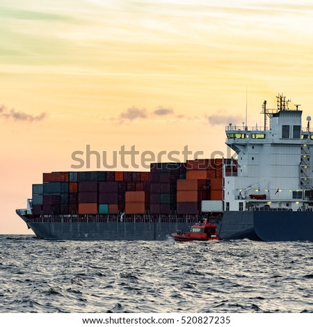 Blue container ship leaving Riga and entering Baltic sea