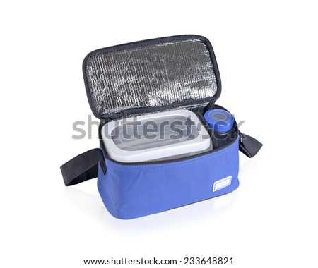 Blue cooler bag filled with plastic bottle and boxes isolated on white - stock photo