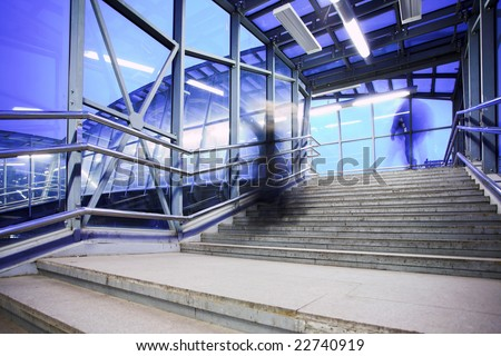 Blue coridor, people mooving near staircase - stock photo